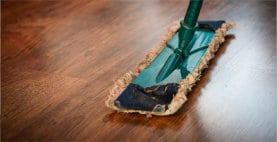 sweeping wooden floor cleaning